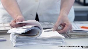 _79609312_f0103547-scientist_checking_through_paperwork-spl-1