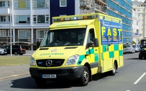 EYF3DT South East Coast Ambulance Service Mercedes Ambulance in Eastbourne East Sussex UK with Stroke Act Fast sign attached blue light
