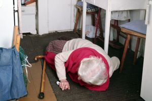 Elderly-Woman-fallen-on-a-kitchen-floor