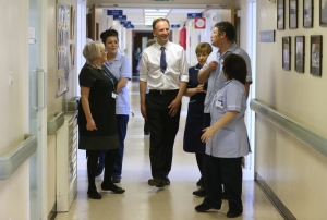 The new chief executive of the NHS, Simon Stevens (C) meets staff during a visit to Shotley Bridge Hospital in Consett, northern England April 1, 2014.   REUTERS/Owen Humphreys/Pool   (BRITAIN - Tags: POLITICS HEALTH) - RTR3JHOL