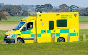 F5A675 NHS South East Coast Ambulance parked by some grass while the crew take a break., in South East England, UK.